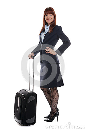 Flight attendant standing with the luggage