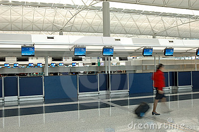 Flight attendant walking through the check-in counter
