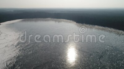 Flight over a frozen lake stock video footage