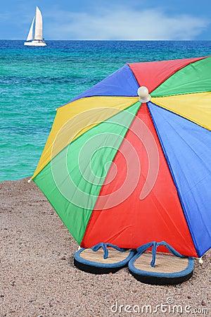 Free Flip-Flops And Beach Umbrella Royalty Free Stock Photos - 31763998