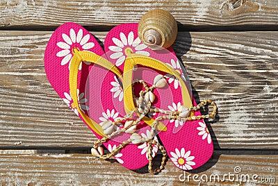Flip flops on beach boardwalk