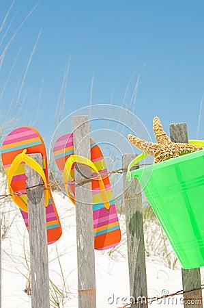 Flip flops on fence