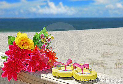 Flip flops and flowers at beach
