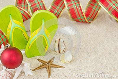 Flip Flops in the sand and Christmas decoration