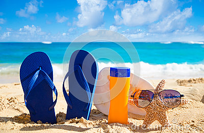 Flip Flops, Seashell, Sunscreen And Starfish With ...
