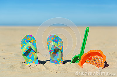 Flip flops and toys at the beach