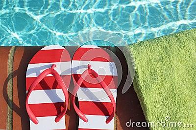 Flips flops by swimming pool