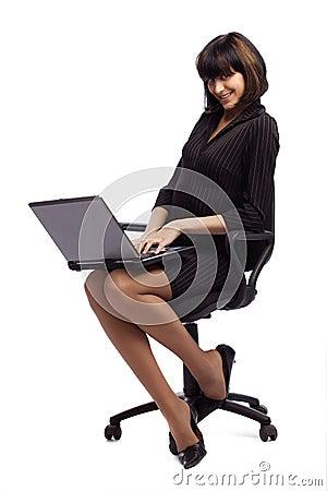 Flirting brunette woman in dark dress sitting