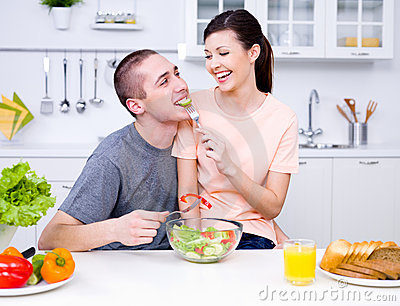 Flirting couple in the kitchen