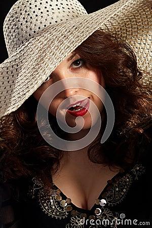 Flirty woman in a hat