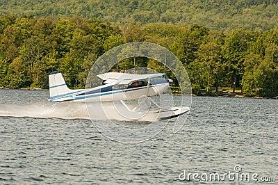 Float plane or seaplane taking off