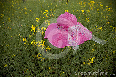 Floating hat in rape flower field