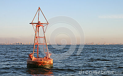 Floating old red buoy