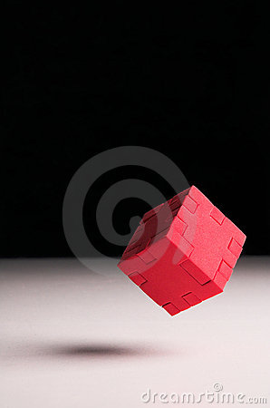 Free Floating Red Puzzle Cube Stock Image - 1316071