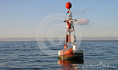 Floating red and white buoy
