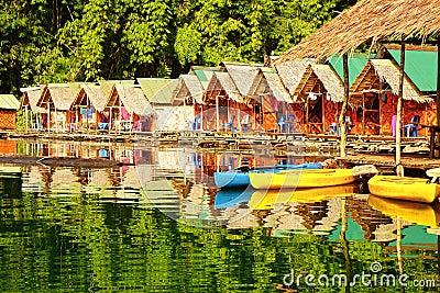 Floating village on Cheow Lan Lake. Editorial Stock Photo