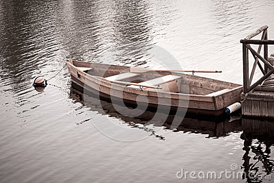 Floating Wooden Boat with Paddles