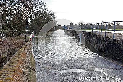 Flooded blocked Village road.