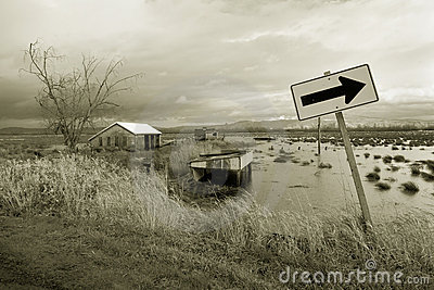 Flooded farm field and sign