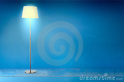 Floor electric lamp over blue