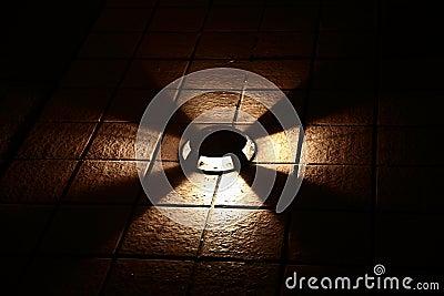 Floor lamp in the darkness
