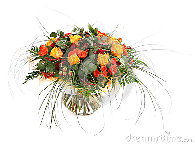 Floral composition of orange roses, hypericum and fern. Flower arrangement in a transparent glass vase. Isolated on white.