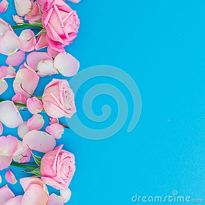 Free Floral Frame Of Roses Buds And Petals On Blue Background. Flat Lay, Top View. Pink Roses Flowers Texture. Valentines Day Stock Photography - 107385922