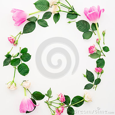 Floral frame with tulip flowers, roses and petals isolated on white background. Flat lay, Top view. Stock Photo