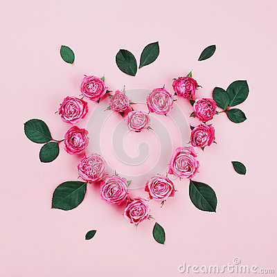 Free Floral Heart Made Of Pink Rose Flowers And Green Leaves On Pastel Background Top View. Flat Lay Styling. Fashion Composition. Royalty Free Stock Photography - 97176807