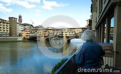 Florence - Ponte Vecchio bridge - gray painter Editorial Photo