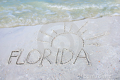 Florida and sun drawn in sand beach vacation