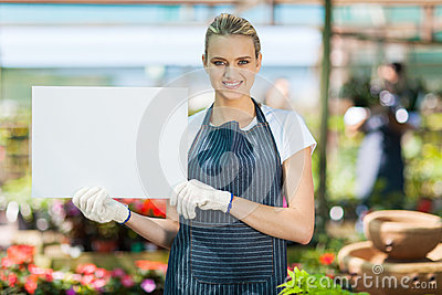 Florist holding white board