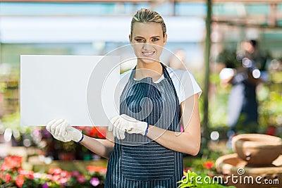 Florist holding white board