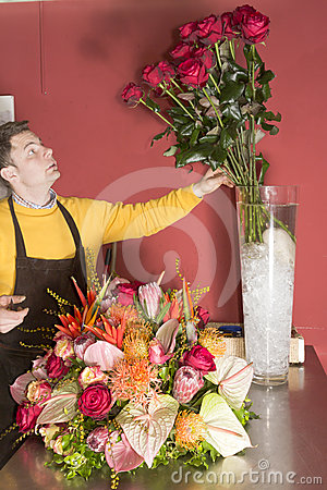 Florist just finishing rich flower arrangement