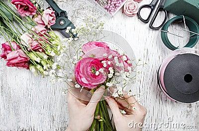Florist at work. Woman making beautiful bouquet