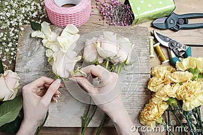 Florist at work. Woman making wedding bouquet