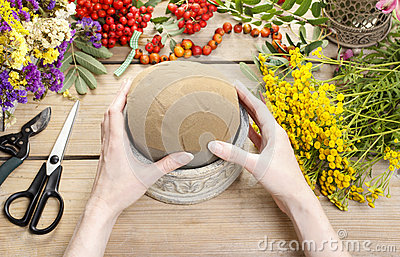 Florist at work: woman using floral foam