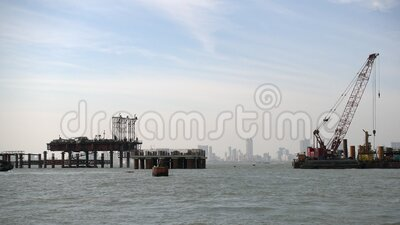 Construction Boats in the Bay. A flotilla of construction boats in the bay at Mumbai, India stock footage