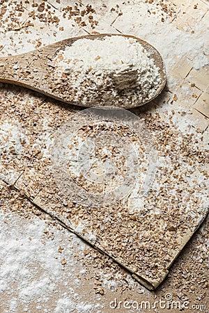 Flour on a wood spoon