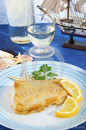 Floured cod cooked in a pan