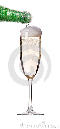 Flow of champagne from bottle into the glass