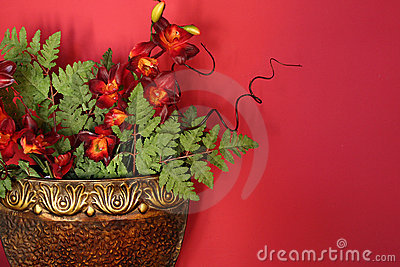 Flower Arrangement Against a Red Wall