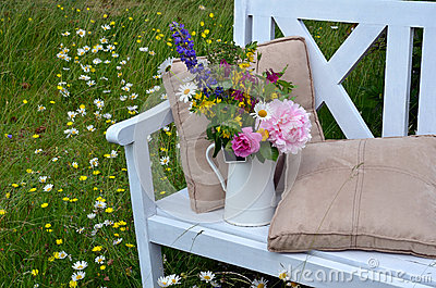 Flower arrangement on bench