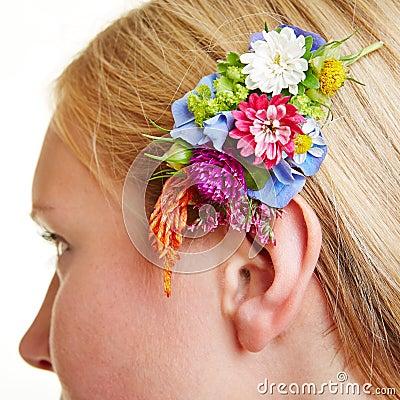 Flower arrangement in blond hair