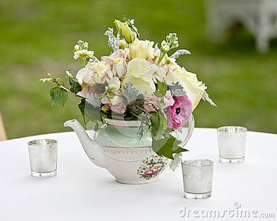 Flower arrangement in old tea pot