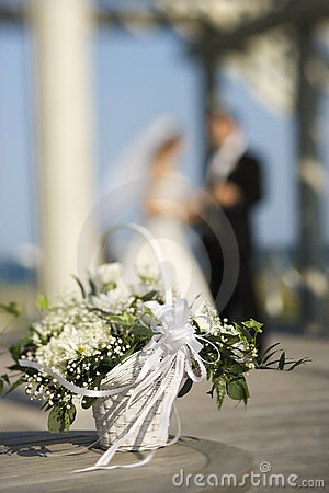 Flower basket with bride and groom.