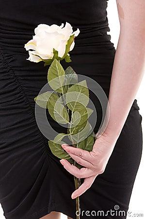 Flower behind female back