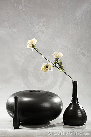 Flower in black vase