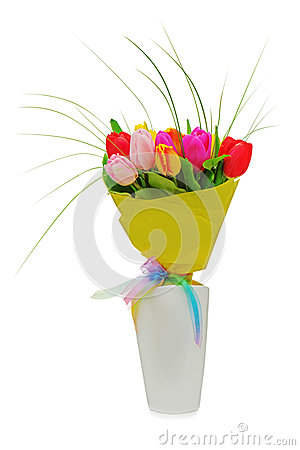 Flower bouquet from colorful tulips in white vase