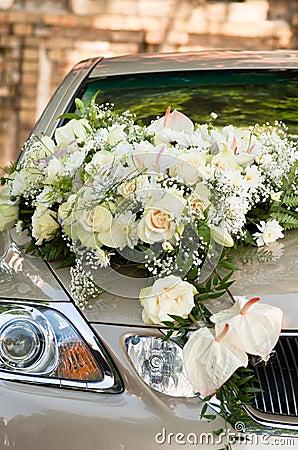 Flower bouquet on wedding car